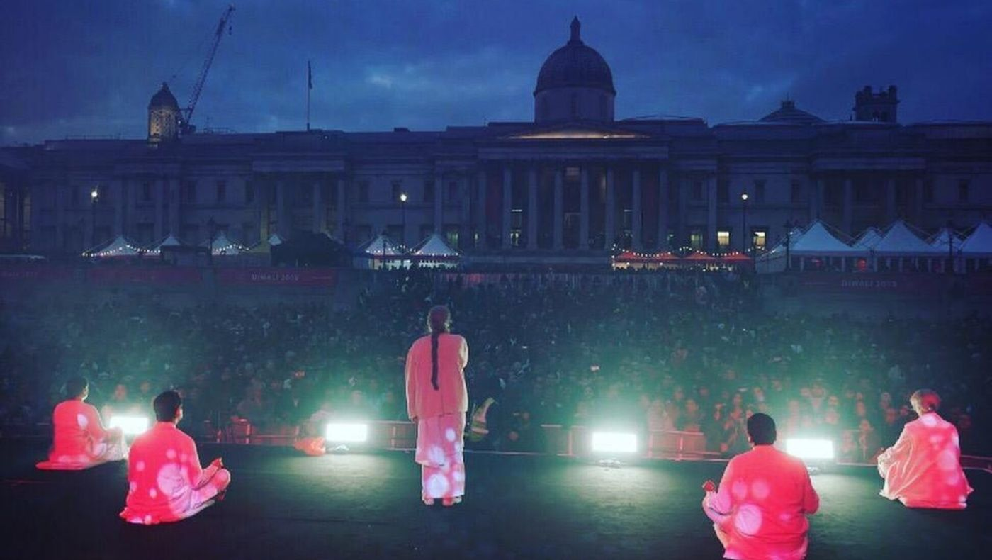 Sister Jayanti leads the crowd into a moment of reflection at Diwali on Trafalgar Square, 2019.